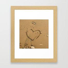 Heart drawn on the sand Framed Art Print