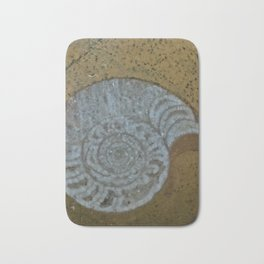 Ammonite in fossilized river bed Bath Mat