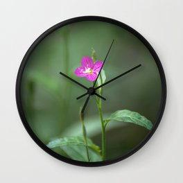 Blooming amid the darkened forest Wall Clock