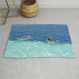 Two smiling dolphins in a zoo Rug