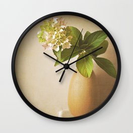 Pale pink Hydrangea flowers in textured vase. Wall Clock