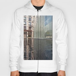 Modern fountain with water splashes on a huge glass window Hoody