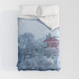 Red house lost in a snowy storm Comforters