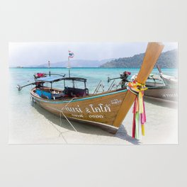 Long tail boat with prow ribbons on beach, Koh Lipe, Satun, Thailand Rug