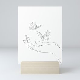 Butterflies on the Palm of the Hand Mini Art Print
