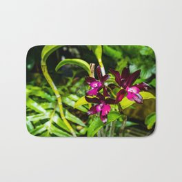 dark purple orchids Bath Mat