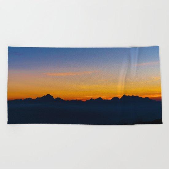 Wispy Mountain Glow Beach Towel
