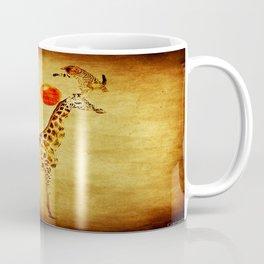 By playing on the giraffe Coffee Mug