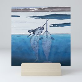 Narwhals emerging from cold ocean Mini Art Print