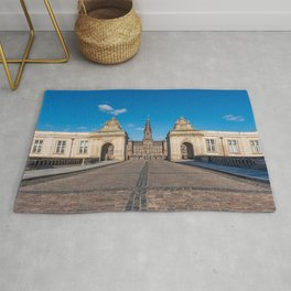 Entrance of Christiansborg Palace under a blue sky on a sunny day Rug
