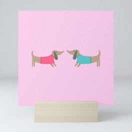 Cute dogs in love with dots in pink background Mini Art Print