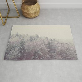 A snow covered woodland in the German Alps Rug