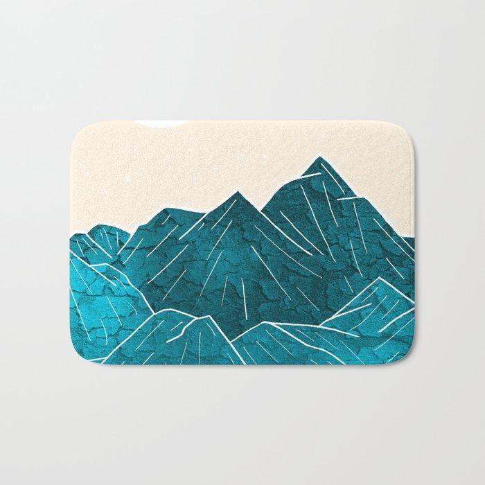 Mountains under the white sun Bath Mat