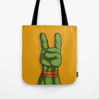 ninja turtle Tote Bags featuring Teenage Mutant Ninja Turtle Hand by MONDOBITGO