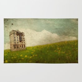 Building in a field Rug