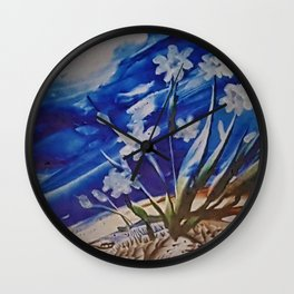 White desert flowers with a blue sky Wall Clock
