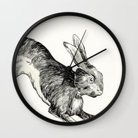 hare Wall Clocks featuring HARE by Riku Ounaslehto