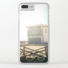 Bike leaning against lifeguard hut on beach Clear iPhone Case