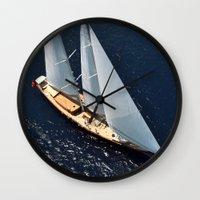 sailboat Wall Clocks featuring sailboat by laika in cosmos