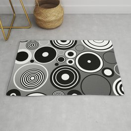 Geometric black and white rings on metallic silver Rug