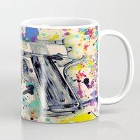 gun Mugs featuring Gun by Maressa Andrioli
