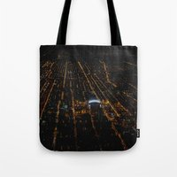 blackhawks Tote Bags featuring United Center: A Standout Arena (Chicago Architecture Collection) by Bob Benenson Photo Art