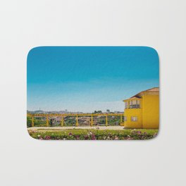 Yellow house with a view Bath Mat