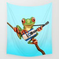 israel Wall Tapestries featuring Tree Frog Playing Acoustic Guitar with Flag of Israel by Jeff Bartels