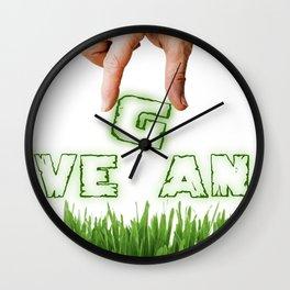 "Hand is composing ""VEGAN"" write Wall Clock"
