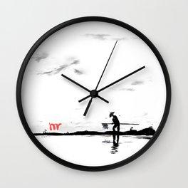 Fisherman at sunrise Wall Clock