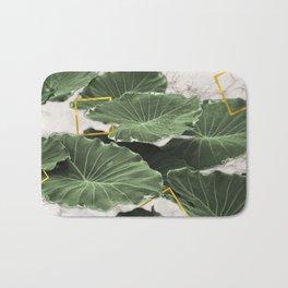 Tropical leaves on marble Bath Mat