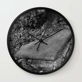 broken old grave on the green Wall Clock