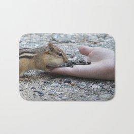 Chipmunk Eating from Hand Bath Mat