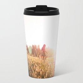 Woman walking through meadow at sunset Travel Mug