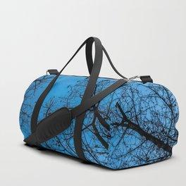 Blue sky over naked trees Duffle Bag