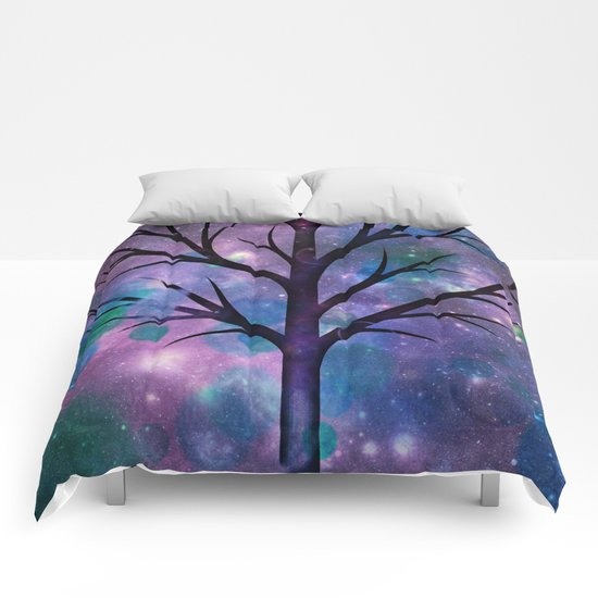 Tree in a fairy-like blue lilac sparkle spring night Comforters