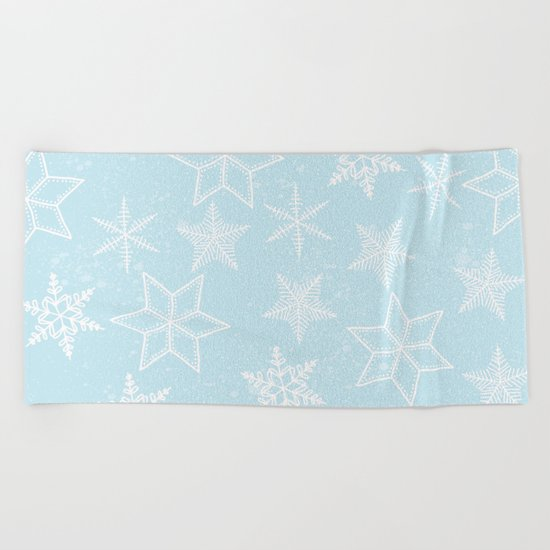 Snowflakes on light blue background Beach Towel