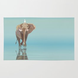 Elephant and white bird against the blue sky Rug