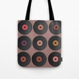9 vinyl records. Tote Bag