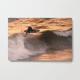 Surfer grabs air on wave at sunset Metal Print