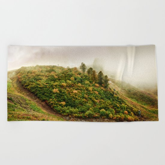 Autumn valley in the cloud Beach Towel
