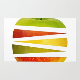 apple cut into pieces on a white background Rug