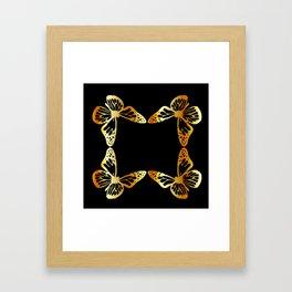 Golden butterflies flying against black Framed Art Print