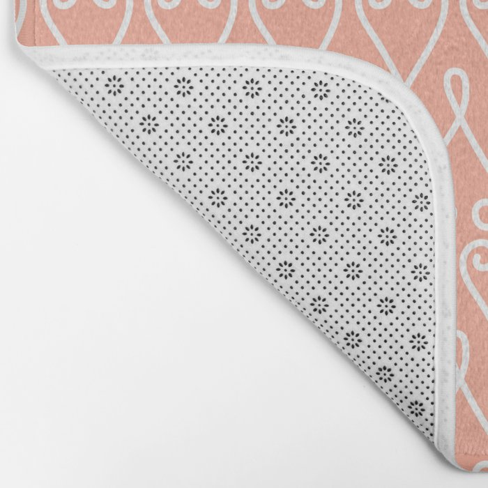 White Ornamental Designs on Pink Background Bath Mat