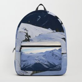 The snowy rocks at mountain tops Backpack
