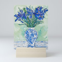 Iris Bouquet in Chinoiserie Vase on Blue and White Striped Tablecloth on Painterly Mint Green Mini Art Print