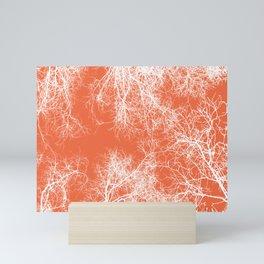 White silhouetted trees on orange Mini Art Print