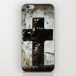 Wrought iron cross against stone iPhone Skin