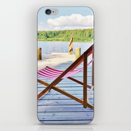 Red deck chair iPhone Skin