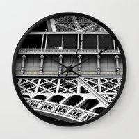 eiffel tower Wall Clocks featuring Eiffel Tower by James Tamim